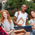 smiling young students standing and talking outdoors stock photo © deandrobot