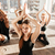 Group of people sitting in lotus pose at yoga studio stock photo © deandrobot