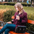 thoughtful woman drinking coffee and using tablet in park stock photo © deandrobot