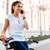 close up portrait of a woman with smartphone on bicycle stock photo © deandrobot