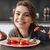 feliz · jovem · senhora · alimentação · peixe · tomates - foto stock © deandrobot