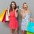 boldog · nő · tart · bevásárlótáskák · stúdió · mosoly - stock fotó © deandrobot