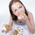 woman eating cake over gray background stock photo © deandrobot