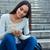 feliz · mujer · sonriente · estudiante · sesión · escaleras · personas - foto stock © deandrobot