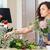 mujer · florista · ramo · flores · pie - foto stock © deandrobot