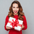 Happy woman in red sweater with a box stock photo © deandrobot