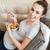 kobieta · w · ciąży · jedzenie · sałatka · owocowa · domu · ciąży · bed - zdjęcia stock © deandrobot