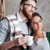 Smiling loving couple bakers drinking coffee stock photo © deandrobot