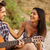man playing guitar for his girlfriend sitting at the tent stock photo © deandrobot
