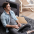 sonriendo · feliz · hombre · sesión · alfombra · casa - foto stock © deandrobot