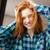 amusing funny girl in checkered shirt with tousled red hair stock photo © deandrobot