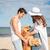 mutlu · çift · sevmek · oturma · plaj · köpek - stok fotoğraf © deandrobot