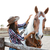 beautiful young woman cowgirl with horse in village stock photo © deandrobot