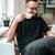 empresario · gafas · sesión · escritorio · mirando - foto stock © deandrobot