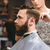 professional hairdresser cutting bearded mans hair stock photo © deandrobot