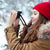 smiling woman walking and taking pictures in winter forest stock photo © deandrobot