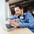 férfi · laptopot · használ · számítógép · iroda · jóképű · férfi · technológia - stock fotó © deandrobot