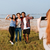 woman taking pictures of her friends with mobile phone outdoors stock photo © deandrobot
