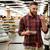 улыбаясь · молодым · человеком · Постоянный · супермаркета · продукции - Сток-фото © deandrobot