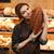 happy woman in supermarket choosing bread stock photo © deandrobot