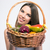 charming girl holding basket with fruits stock photo © deandrobot