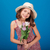 lovely smiling little girl in hat with bouquet of flowers stock photo © deandrobot