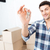 happy man moving showing keys in his new flat stock photo © deandrobot