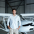 confident man standing in front of small aircraft stock photo © deandrobot