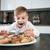 fiatal · srác · konyha · eszik · sütik · fiú · elvesz - stock fotó © deandrobot