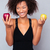 smiling african woman holding apples stock photo © deandrobot