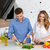 beautiful couple cooking healthy food together stock photo © deandrobot
