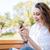 молодые · женщины · студент · за · пределами · сотового · телефона · сидят - Сток-фото © deandrobot