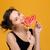 cute amusing young woman biting sweet heart shaped lollipop stock photo © deandrobot