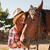 beautiful woman cowgirl standing and kissing her horse stock photo © deandrobot