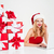 woman in santa claus hat using laptop near gift boxes stock photo © deandrobot