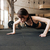 fitness woman working out and doing pushups in gym stock photo © deandrobot