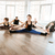 group of people stretching and doing yoga exercises stock photo © deandrobot