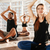 group of people meditating in lotus pose at yoga studio stock photo © deandrobot