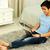 笑みを浮かべて · アジア · 男 · 座って · カーペット - ストックフォト © deandrobot