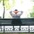 üzletember · pihen · pad · kint · hátulnézet · portré - stock fotó © deandrobot