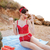 pin up girl showing okay sign at the beach outdoors stock photo © deandrobot