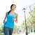 happy young woman running outdoors stock photo © deandrobot