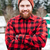 cheerful bearded man standing with hands folded in winter stock photo © deandrobot