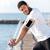 sportsman listening to music fron blank screen smartphone on pier stock photo © deandrobot