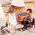 couple relaxing and playing guitar in wigwam on the beach stock photo © deandrobot