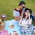 tender young couple having picnic outdoors stock photo © deandrobot