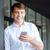 glimlachend · aantrekkelijk · jonge · zakenman · permanente · smartphone - stockfoto © deandrobot