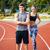 nő · sportruha · nyújtás · fiatalember · néz · fitnessz - stock fotó © deandrobot