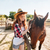 beautiful woman cowgirl taking care of her horse on farm stock photo © deandrobot