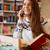 mujer · libro · hablar · teléfono · biblioteca - foto stock © deandrobot